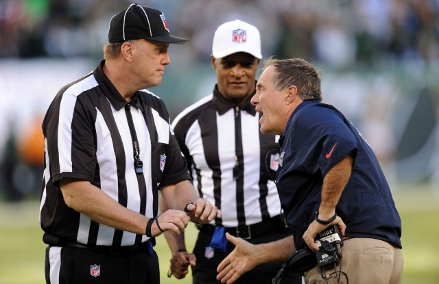 Bill Belichick argues the penalty that continued the New York game-winning drive. (USATSI)