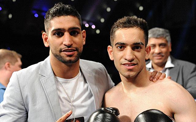 Amir Khan (left, with brother Haroon) might have Floyd Mayweather in his sights. (USATSI)