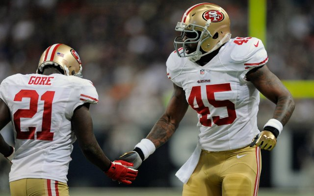 Brandon Jacobs isn't such a big fan of Jim Harbaugh. (USATSI)