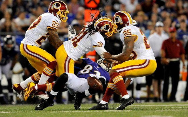 Brandon Meriweather (No. 31) was fined for his hit on Torrey Smith. (Getty Images)