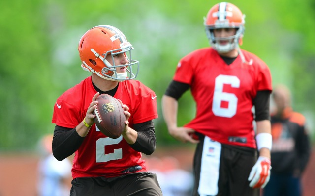 Brian Hoyer looks over the shoulder of his backup, Johnny Manziel. (USATSI)