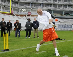 B. Urlacher practices cricket in London (AP).