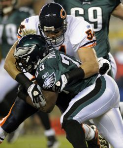 B. Urlacher tackles L. McCoy (AP).