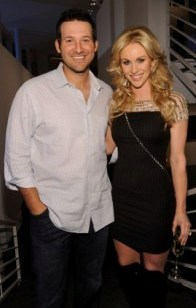 T. Romo and his wife, Candice Crawford (Getty).