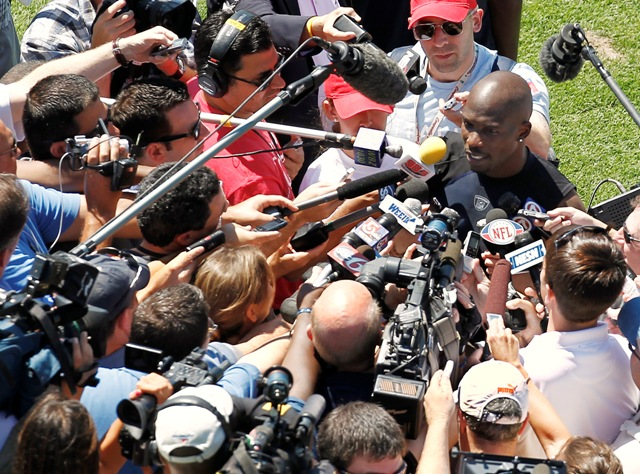 C. Ochocinco meets the media for the first time (AP).