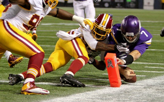 Christian Ponder dislocated his shoulder on this hit from DeAngelo Hall. (USATSI)