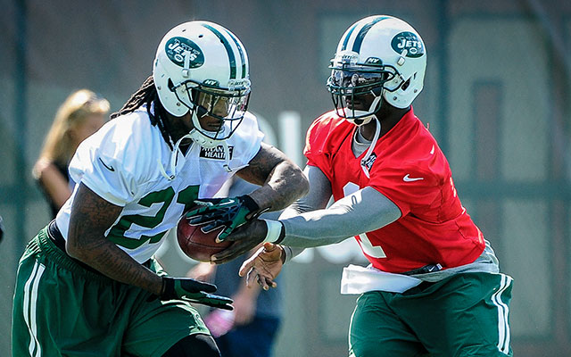 When it comes to a foot race, Michael Vick wants no part of Chris Johnson. (USATSI)
