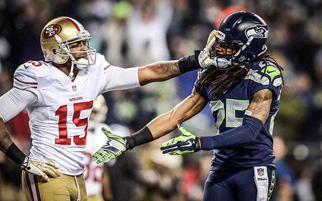 Sherman says 'good game,' Crabtree gives him the Heisman treatment. (USATSI)
