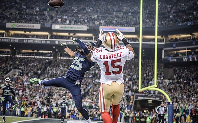Richard Sherman takes the ball from 49ers Crabtree