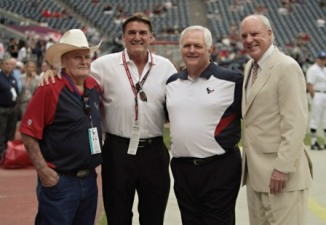 Dan Pastorini with Bum Phillips, Wade Phillips and Bob McNair (Getty).