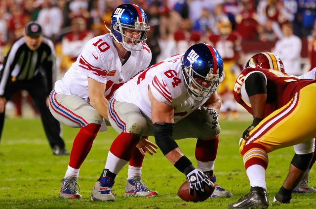 Eli Manning won't be taking snaps from David Baas the rest of the season. (USATSI)
