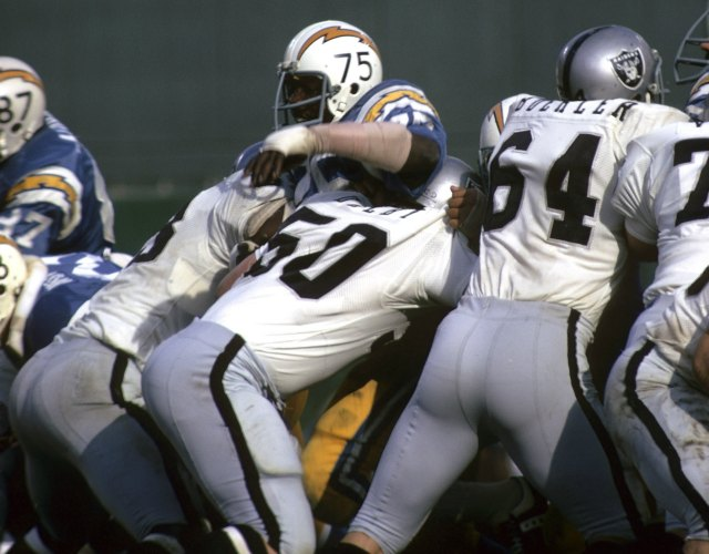 Deacon Jones is double-teamed by Oakland in 1972. (Getty Images)