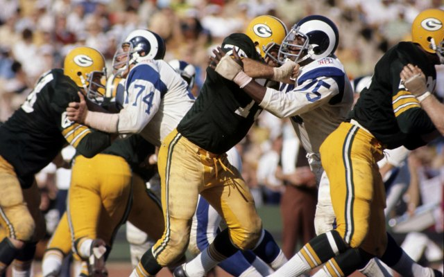 Deacon Jones goes up against Forrest Gregg. (Getty Images)