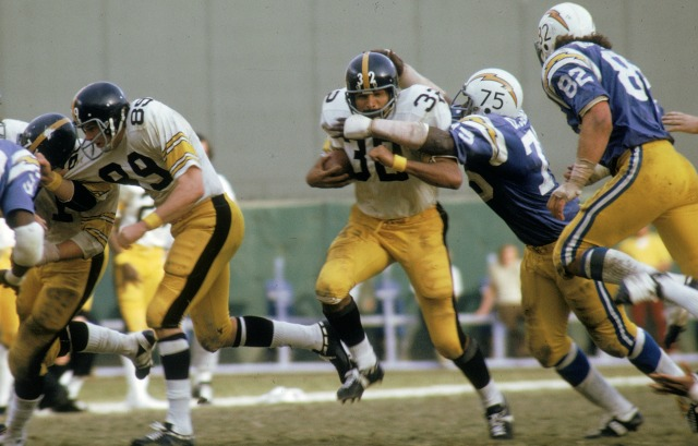 Deacon Jones takes down Franco Harris in 1973. (Getty Images)