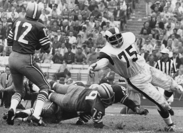 Deacon Jones only has eyes for John Brodie in the late 1960s. (Getty Images)