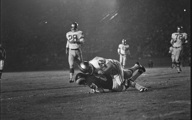 Dick Lebeau tackles L.A. Rams wide receiver Carroll Dale in 1963. (Getty Images)