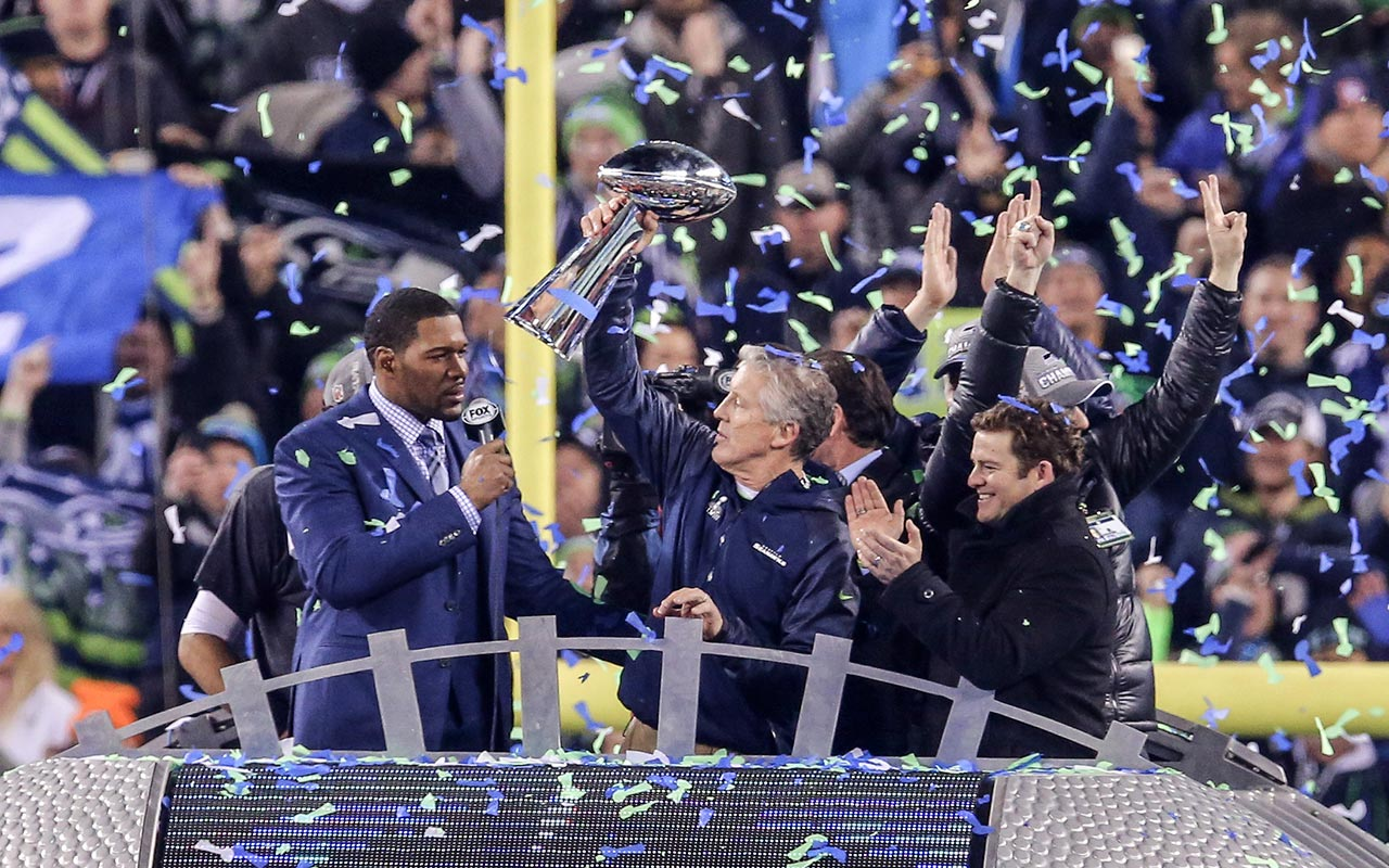 Pete Carroll hoists the Lombardi Trophy after the game. (USATSI)