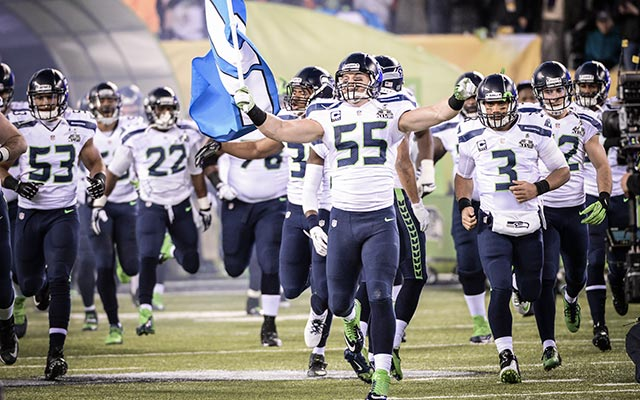 Heath Farwell carried the 12th man flag for the Seahawks. (USATSI)