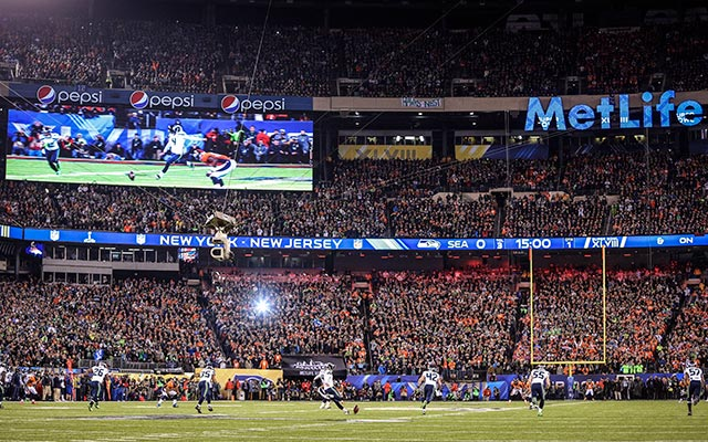 Seahawks kicker Steven Hauschka kicks off as one lonely bulb flashes in the distance. (USATSI)