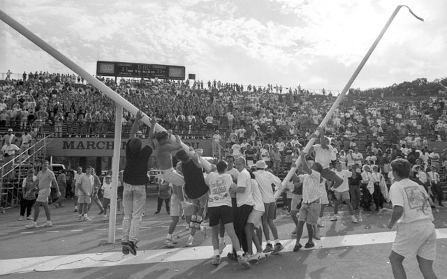Colorado fans pull down the goal posts at Faurot Field in Columbia, Missouri. (Getty Images)