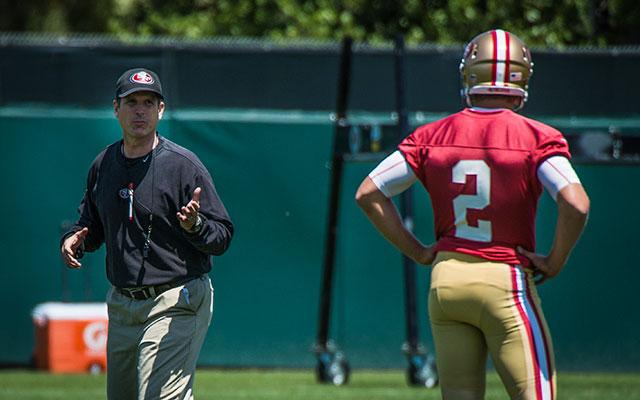Jim Harbaugh talks to Blaine Gabbert during 49ers minicamp. (USATSI)