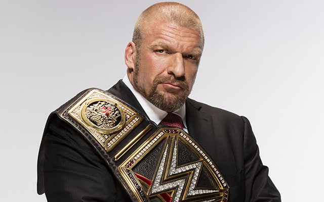 Paul Levesque is not only the champion, he's also an executive VP. (WWE)