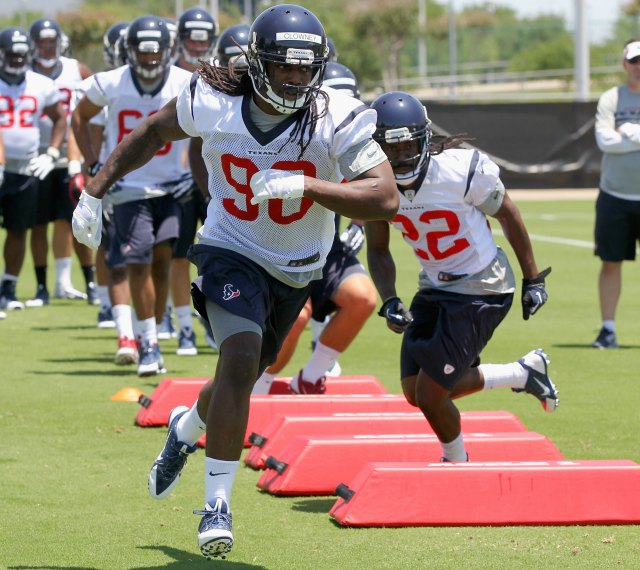 The No. 1 overall pick, Jadeveon Clowney, runs through a drill. (Getty Images)