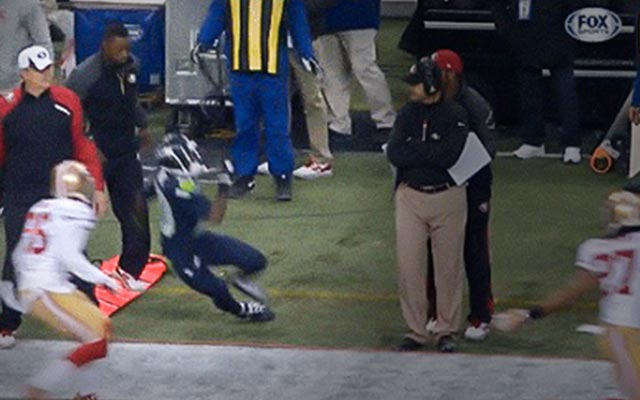 Seahawks' gunner Jeremy Lane goes down on the 49ers' sidelines. (FOX)