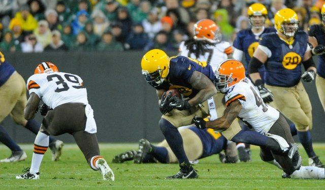 Jermichael Finley injured his spine while taking this hit from Tashaun Gipson. (USATSI)