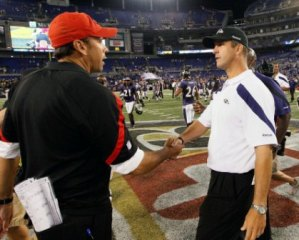 Todd Haley and John Harbaugh share a handshake and some words (AP).