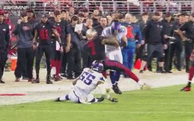 Colin Kaepernick hit hard by Minnesota Vikings safety Harrison Smith during the San Francisco 49ers' home opener on Monday Night Football.