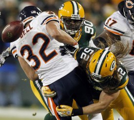 K. Bell gained 121 yards in Chicago's loss to Green Bay (AP).