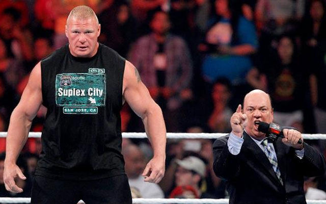Brock Lesnar stands tall and confident next to Paul Heyman. (WWE)