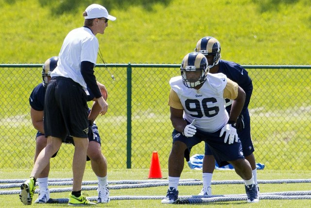 Michael Sam is being watched by Rams special teams coach John Fassel. (USATSI)