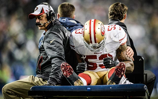 NaVarro Bowman leaves the field after suffering a serious knee injury. (USATSI)