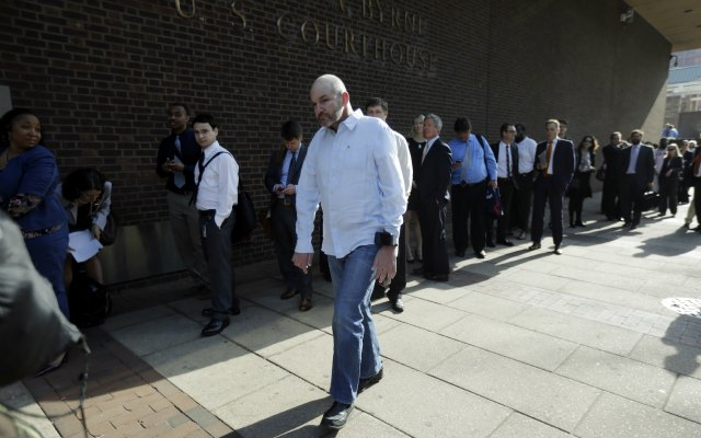 Former NFL player Kevin Turner, who suffers from ALS, walks into the courthouse Tuesday morning. (AP)