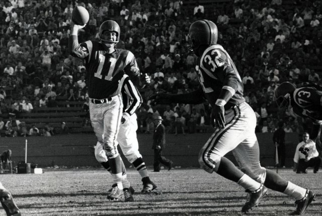 A decade before this photo, Norm Van Brocklin, seen here passing to Jim Brown, threw for 554 yards. (USATSI)