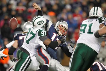 C. Pace forces a fumble on T. Brady in New York's win (US Presswire).