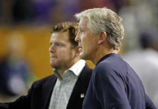 Pete Carroll and John Schneider (US Presswire).