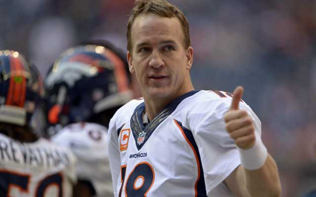 Peyton Manning drops the thumbs up to the Houston crowd following his record-setting TD. (USATSI)