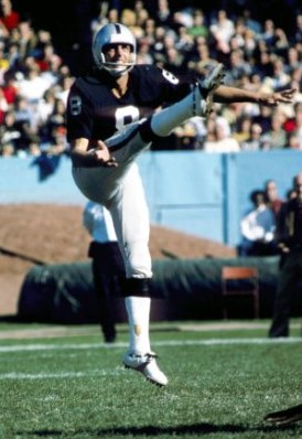 Ray Guy punting in 1974 (Getty).