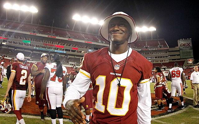 How long will Jay Gruden still with RG3 if the QB continues to struggle? (USATSI)