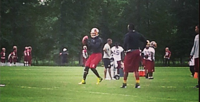 Here's photographic proof that Robert Griffin III took throws Thursday. (Redskins)