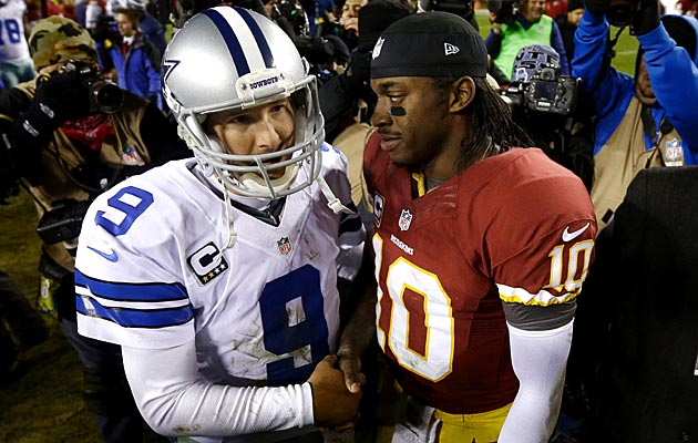 RG3 offers Romo words of encouragement. (AP)