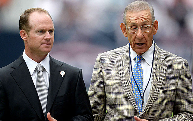 Stephen Ross, right, and Jeff Ireland were thanked by Ted Wells. (USATSI)