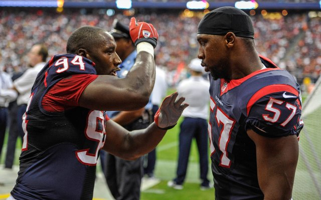 Antonio Smith, left, explains technique to Sam Montgomery. (USATSI)