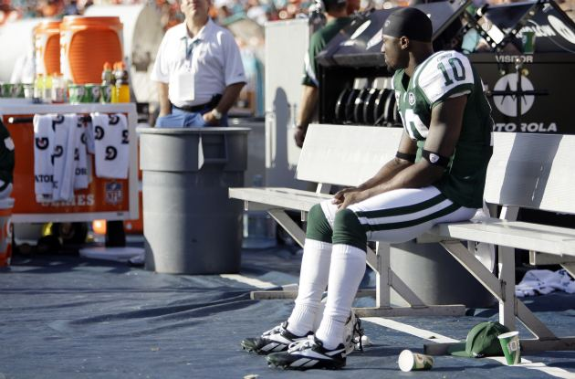 For now, all Santonio Holmes can do is sit on the bench. (USATSI)