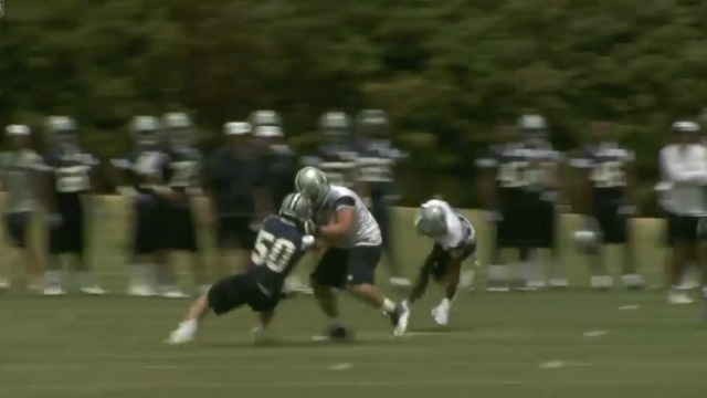 Sean Lee gets pancaked here by Zack Martin on Tuesday. (NFL.com)