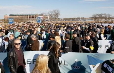 Super Bowl fans prepare to enter the stadium on Super Bowl XLV (Getty).