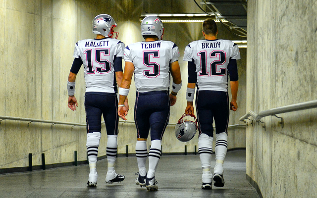 Will Ryan Mallett and Tom Brady still be Tim Tebow's teammates after Saturday?. (USATSI)